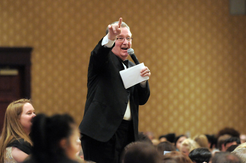 Auctioneer Paul C. Behr takes paddle bids at different donation levels raising over $121,00 at  the Bal Swan Ball at the Omni Interlocken Resort Hotel on Saturday.<br /> March 3, 2012 <br /> staff photo/ David R. Jennings