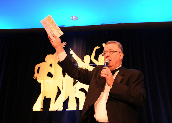 Auctioneer Paul C. Behr takes bids for the live auction at the Bal Swan Ball at the Omni Interlocken Resort Hotel on Saturday.<br /> March 3, 2012 <br /> staff photo/ David R. Jennings