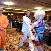 Sara Pringle, right , and her husband Chad head to the dance floor with Beau Smith, left, at the Bal Swan Ball, Saturday Night Fever, fundraiser at the Omni Interlocken Resort Hotel on Saturday.<br /> <br /> March 3, 2012 <br /> staff photo/ David R. Jennings