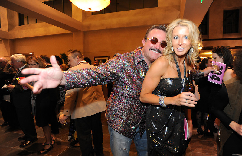 Chris Holston and Amanda Enloe pose for pictures while attending the Bal Swan Ball, Saturday Night Fever, fundraiser at the Omni Interlocken Resort Hotel on Saturday.<br /> March 3, 2012 <br /> staff photo/ David R. Jennings