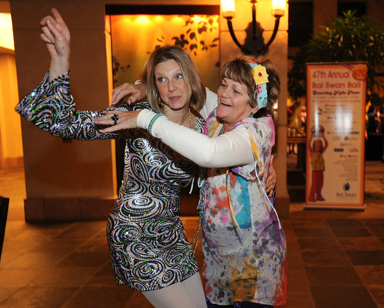 Nicole Parten, left, and Patti Willardson pose for pictures while attending the Bal Swan Ball at the Omni Interlocken Resort Hotel on Saturday.<br /> March 3, 2012 <br /> staff photo/ David R. Jennings