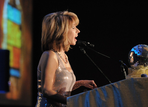 Kim Christianson, master of ceremonies, speaks to the audience at the Bal Swan Ball at the Omni Interlocken Resort Hotel on Saturday.<br /> March 3, 2012 <br /> staff photo/ David R. Jennings
