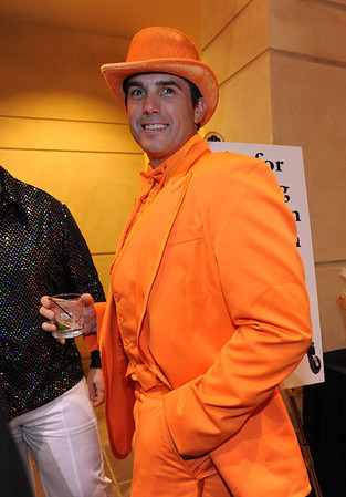 Beau Smith dressed in an orange suit  and hat for the Bal Swan Ball, Saturday Night Fever, at the Omni Interlocken Resort Hotel on Saturday.<br /> March 3, 2012 <br /> staff photo/ David R. Jennings