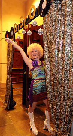 Sara Pringle, Bal Swan teacher, poses at the door of the ballroom while attending the Bal Swan Ball, Saturday Night Fever, fundraiser at the Omni Interlocken Resort Hotel on Saturday.<br /> March 3, 2012 <br /> staff photo/ David R. Jennings