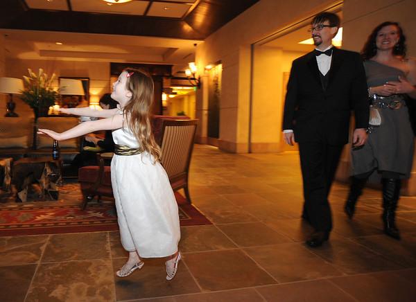Lily Conly runs to greet Bal Swan Children's Center teachers arriving at the Bal Swan Ball at the Omni Interlocken Resort Hotel on Saturday.<br /> March 3, 2012 <br /> staff photo/ David R. Jennings