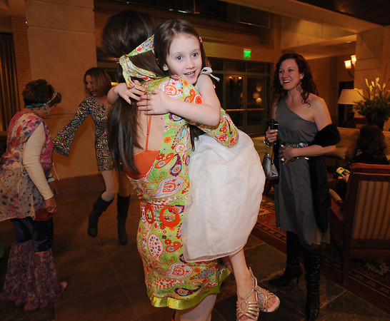Lily Conly, right, greets Bal Swan Children's Center teacher Amanda Dunwoody  at the Bal Swan Ball at the Omni Interlocken Resort Hotel on Saturday.<br /> March 3, 2012 <br /> staff photo/ David R. Jennings