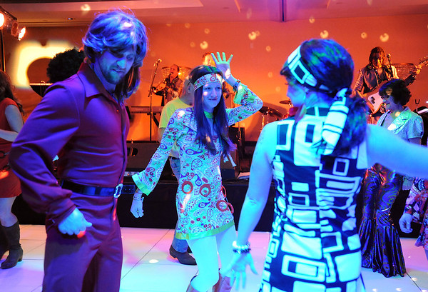 Brent Edwards, right, dances with his wife Kiley, right, and Amanda Dunwoody , center, to the music performed by the Naco Men at the Bal Swan Ball, Saturday Night Fever, fundraiser at the Omni Interlocken Resort Hotel on Saturday.<br /> March 3, 2012 <br /> staff photo/ David R. Jennings