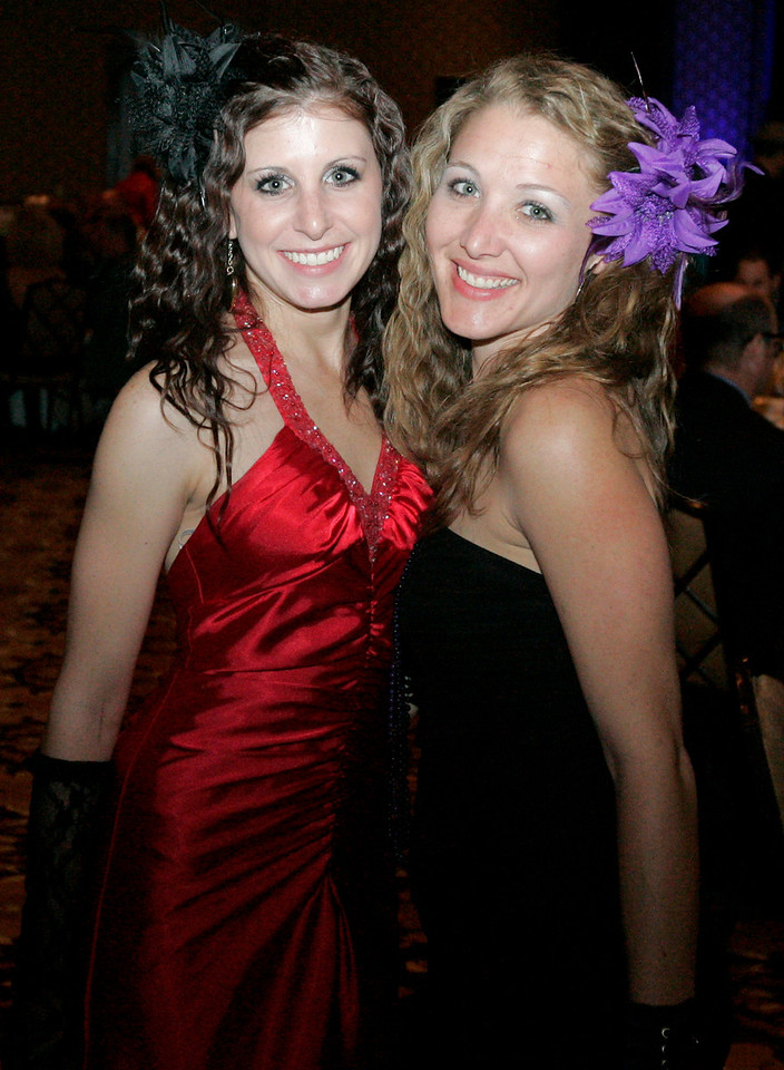 Julianna Longo, left and Sarah Pringle show off the 80's look at the Totally Awesome 80's Bal Swan Ball on Saturday night at the Omni Interlocken Hotel Ballroom.<br /> March 5, 2011<br />  photo/Matt Kelley