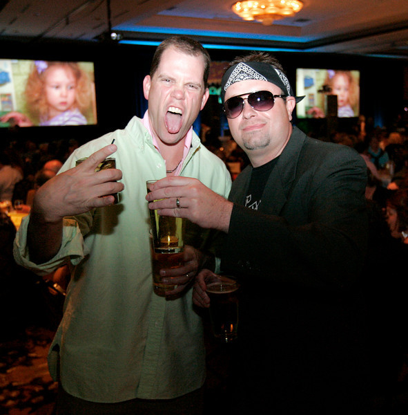Len Koch, left, and Matt Harless, loosen up at the Totally Awesome 80's Bal Swan Ball on Saturday night at the Omni Interlocken Hotel Ballroom.<br /> March 5, 2011<br />  photo/Matt Kelley