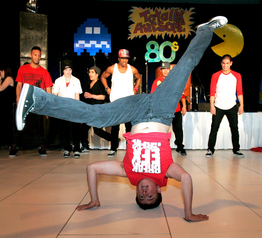 Adrian Ordonez preforms with the BREAKFX break-dancing troupe at the Totally Awesome 80's Bal Swan Ball on Saturday night at the Omni Interlocken Hotel Ballroom.<br /> March 5, 2011<br />  photo/Matt Kelley