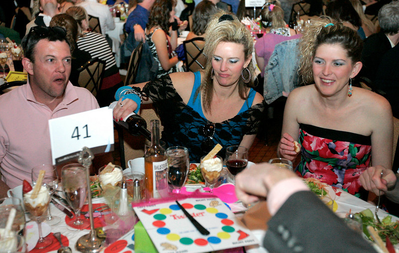 Greg Larson, left, Rachel Larson and Angela McCabe enjoy themselves at the Totally Awesome 80's Bal Swan Ball on Saturday night at the Omni Interlocken Hotel Ballroom. <br /> March 5, 2011<br />  photo/Matt Kelley