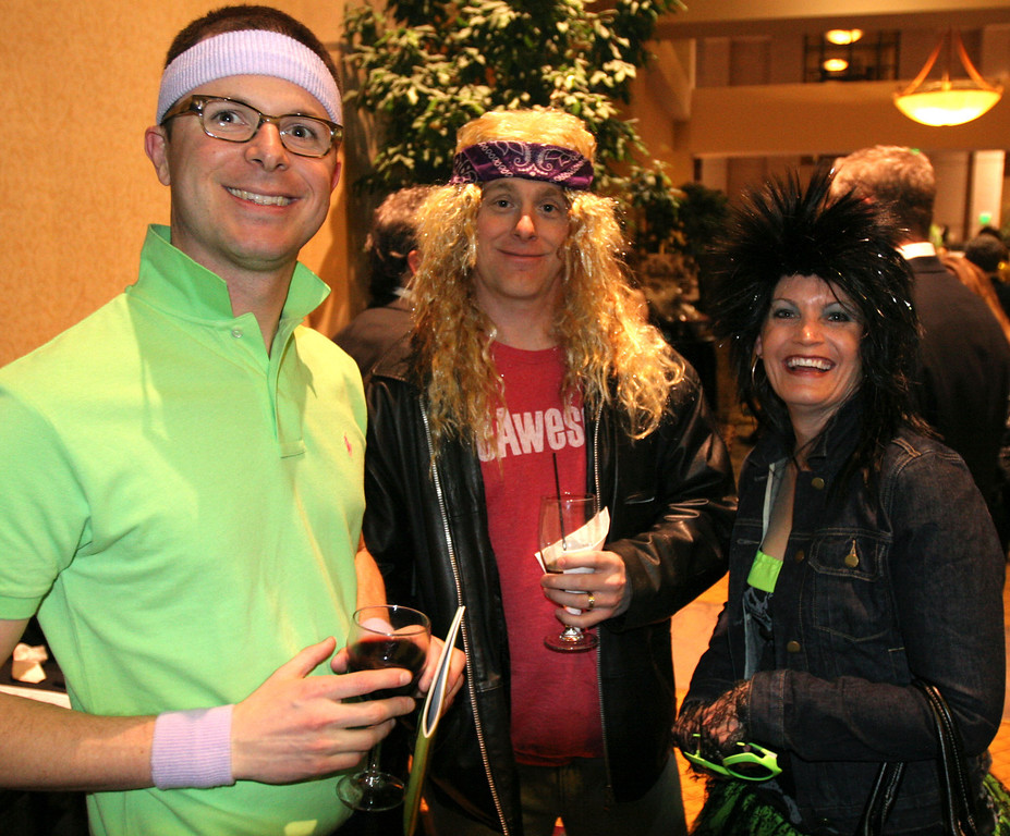 Jaje Pearson, left, and Scott and Virginia Brown show off their 80's attire at the Totally Awesome 80's Bal Swan Ball on Saturday night at the Omni Interlocken Hotel Ballroom. <br /> March 5, 2011<br />  photo/Matt Kelley