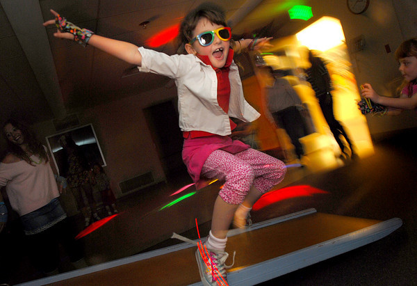 BE1111PINT03<br /> Mackenzie Jones, 6, dances during the Bal Swan Children's Center Pint-Sized Ball on Saturday.<br /> November 6, 2010<br /> staff photo/David R. Jennings