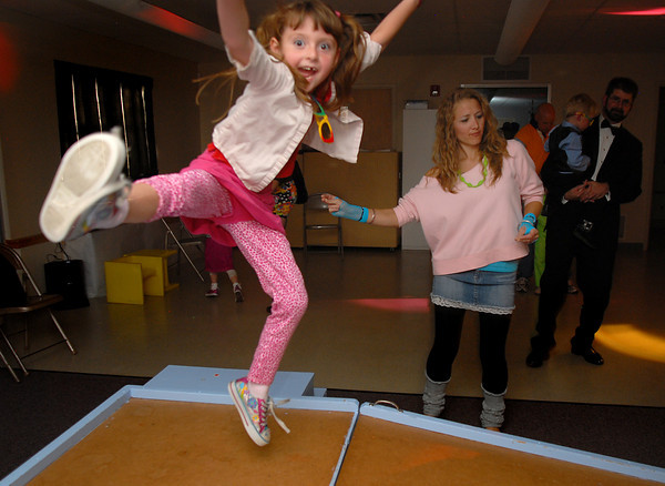 Mackenzie Jones, 6, goes in the air while dancing with staff member Sara Pringle during the Bal Swan Children's Center Pint-Sized Ball on Saturday.<br /> November 6, 2010<br /> staff photo/David R. Jennings