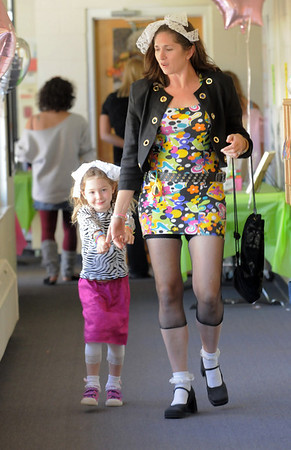 Cheryll Clark, right, walks with her daughter Corinne, 4, to the play room during the Bal Swan Children's Center Pint-Sized Ball on Saturday.<br /> November 6, 2010<br /> staff photo/David R. Jennings