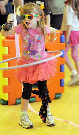 Kayleigh Jones, 4, tries the hula hoop during the Bal Swan Children's Center Pint-Sized Ball on Saturday.<br /> November 6, 2010<br /> staff photo/David R. Jennings