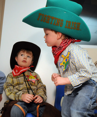 Brothers Zach Hughes, 5, left, and Brandon, 4, wait to dance in their cowboy outfits at Bal Swan Children's Center's Pint Sized Ball aty the center on Saturday.<br /> <br /> November 14, 2009<br /> Staff photo/David R. Jennings