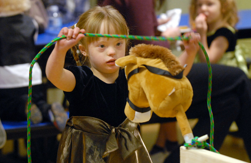 Abigail Meyer, 5, ropes a horse at Bal Swan Children's Center's Pint Sized Ball aty the center on Saturday.<br /> <br /> November 14, 2009<br /> Staff photo/David R. Jennings