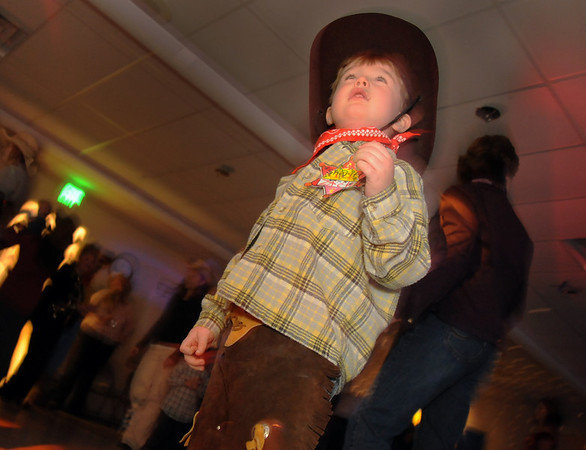 Zach Hughes, 5, dances at Bal Swan Children's Center's Pint Sized Ball aty the center on Saturday.<br /> <br /> November 14, 2009<br /> Staff photo/David R. Jennings