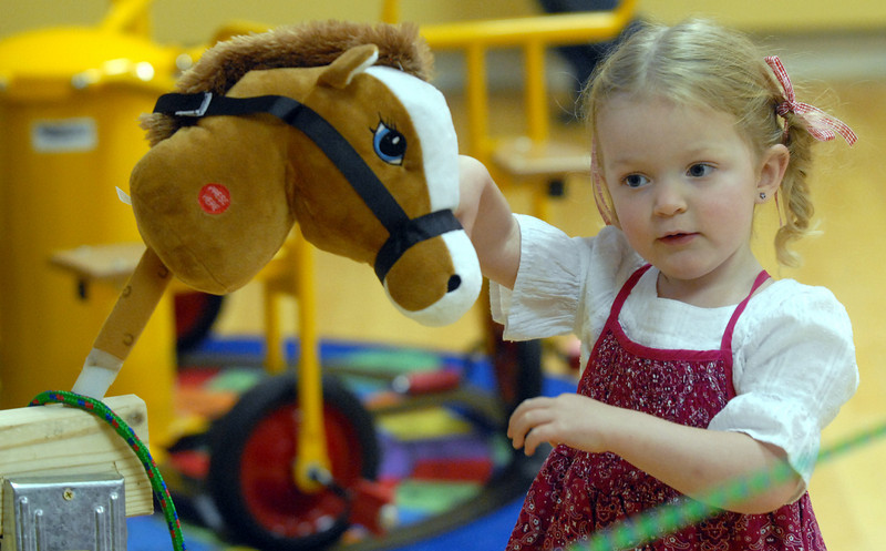 Reese Young, 2 1/2, plays with a roping pony at Bal Swan Children's Center's Pint Sized Ball aty the center on Saturday.<br /> <br /> November 14, 2009<br /> Staff photo/David R. Jennings