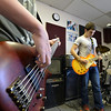 Josh Sheinberg, 14, right, and bass guitarist Matt Maginity, 16, play  during practice for their band Balancing Opposites at Global Sound Studios on Saturday.<br /> March 2, 2013<br /> staff photo/ David R. Jennings