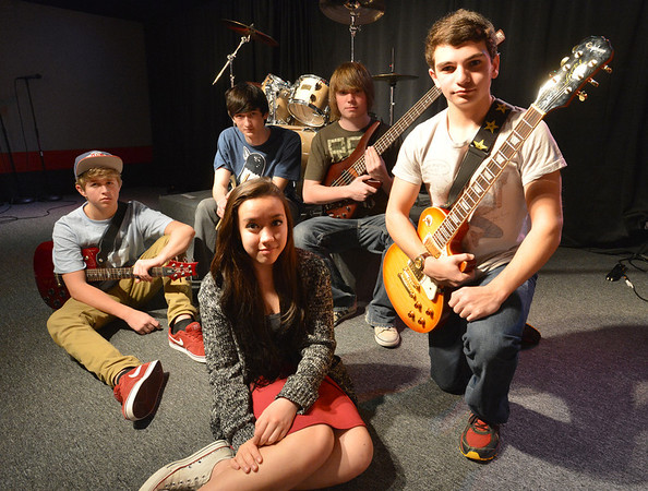 Balancing Opposites band members Aiyana Cary-Alviar, 14, front center, Josh Sheinberg, 14, right, Jack Lacy, 15, left, Kota Young, 17, and Matt Maginity, 16, pose at Global Sound Studios on Saturday.<br /> March 2, 2013<br /> staff photo/ David R. Jennings