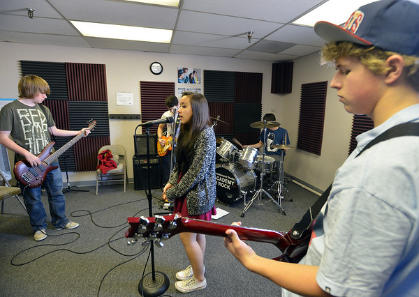 Balancing Opposites with Matt Maginity, left, Aiyana Cary-Alviar, Jack Lacy, Josh Sheinberg and Kota Young practice at Global Sound Studios on Saturday.<br /> March 2, 2013<br /> staff photo/ David R. Jennings