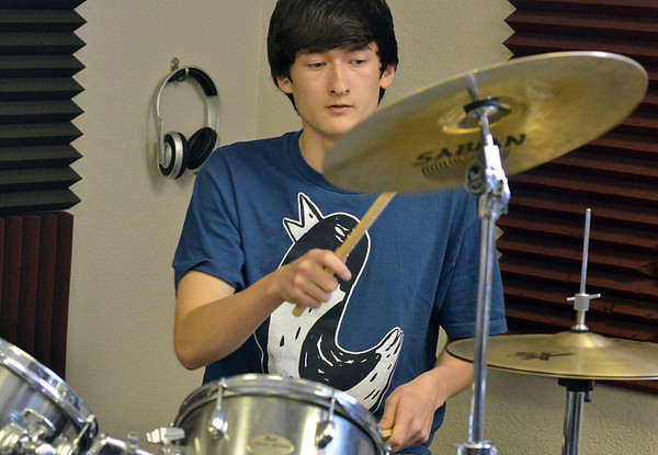 Balancing Opposites drummer Kota Young, 17, plays during practice at Global Sound Studios on Saturday.<br /> March 2, 2013<br /> staff photo/ David R. Jennings