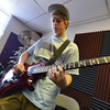 Jack Lacy, 15, plays guitar during practice for the band Balancing Opposites at Global Sound Studios on Saturday.<br /> March 2, 2013<br /> staff photo/ David R. Jennings