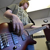 Bass guitarist Matt Maginity, 16,  plays during practice for the band Balancing Opposites at Global Sound Studios on Saturday.<br /> March 2, 2013<br /> staff photo/ David R. Jennings