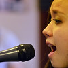 Aiyana Cary-Alviar, 14, sings the vocals  during practice for the band Balancing Opposites at Global Sound Studios on Saturday.<br /> March 2, 2013<br /> staff photo/ David R. Jennings
