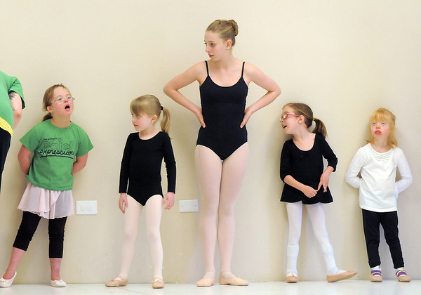 """Ballet assistant Marie Marcus, 14, center, waits with students Abigail Meyer, 8, left, Lilian Prichard, 5, Riley Tuttle, 7, and Jillian Ball, 6, during Ballet Nouveau Colorado's Ballet Expressions classes for the physically and mentally challenged students on Thursday at the BNC studios.<br /> For more photos please see  <a href=""""http://www.broomfieldenterprise.com"""">http://www.broomfieldenterprise.com</a>.<br /> January 12, 2012<br /> staff photo/ David R. Jennings"""