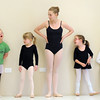 "Ballet assistant Marie Marcus, 14, center, waits with students Abigail Meyer, 8, left, Lilian Prichard, 5, Riley Tuttle, 7, and Jillian Ball, 6, during Ballet Nouveau Colorado's Ballet Expressions classes for the physically and mentally challenged students on Thursday at the BNC studios.<br /> For more photos please see  <a href=""http://www.broomfieldenterprise.com"">http://www.broomfieldenterprise.com</a>.<br /> January 12, 2012<br /> staff photo/ David R. Jennings"