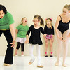 "Instructor Heather Sutton, left, and ballet assistant Marie Marcus, 14, right, guide Riley Tuttle, 7, with dancing to the seasons during Ballet Nouveau Colorado's Ballet Expressions classes for the physically and mentally challenged students on Thursday at the BNC studios.<br /> For more photos please see  <a href=""http://www.broomfieldenterprise.com"">http://www.broomfieldenterprise.com</a>.<br /> January 12, 2012<br /> staff photo/ David R. Jennings"