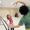 "Kara Newton, 8, left, works with instructor Heather Sutton on ballet positions at the bar during Ballet Nouveau Colorado's Ballet Expressions classes for the physically and mentally challenged students on Thursday at the BNC studios.<br /> For more photos please see  <a href=""http://www.broomfieldenterprise.com"">http://www.broomfieldenterprise.com</a>.<br /> January 12, 2012<br /> staff photo/ David R. Jennings"