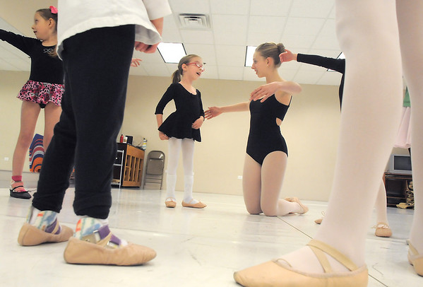 "Ballet assistant Marie Marcus, 14, center right, helps Riley Tuttle, 7, with ballet positions during Ballet Nouveau Colorado's Ballet Expressions classes for the physically and mentally challenged students on Thursday at the BNC studios.<br /> For more photos please see  <a href=""http://www.broomfieldenterprise.com"">http://www.broomfieldenterprise.com</a>.<br /> January 12, 2012<br /> staff photo/ David R. Jennings"
