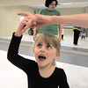 "Lilian Prichard, 5, holds the hand of ballet assistant Gabby Lozano, 12,  while dancing during Ballet Nouveau Colorado's Ballet Expressions classes for the physically and mentally challenged students on Thursday at the BNC studios. <br /> For more photos please see  <a href=""http://www.broomfieldenterprise.com"">http://www.broomfieldenterprise.com</a>.<br /> January 12, 2012<br /> staff photo/ David R. Jennings"