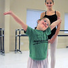 """Abigail Meyer, 8, center, finishes her dance as ballet assistant Gabby Lozano, 12, watches during Ballet Nouveau Colorado's Ballet Expressions classes for the physically and mentally challenged students on Thursday at the BNC studios.<br /> For more photos please see  <a href=""""http://www.broomfieldenterprise.com"""">http://www.broomfieldenterprise.com</a>.<br /> January 12, 2012<br /> staff photo/ David R. Jennings"""