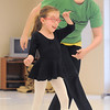 "Instructor Heather Sutton guides Riley Tuttle, 7, while dancing across the floor during Ballet Nouveau Colorado's Ballet Expressions classes for the physically and mentally challenged students on Thursday at the BNC studios.<br /> For more photos please see  <a href=""http://www.broomfieldenterprise.com"">http://www.broomfieldenterprise.com</a>.<br /> January 12, 2012<br /> staff photo/ David R. Jennings"