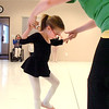 "Instructor Heather Sutton helps Riley Tuttle, 7, with combining ballet positions for a dance during Ballet Nouveau Colorado's Ballet Expressions classes for the physically and mentally challenged students on Thursday at the BNC studios.<br /> For more photos please see  <a href=""http://www.broomfieldenterprise.com"">http://www.broomfieldenterprise.com</a>.<br /> January 12, 2012<br /> staff photo/ David R. Jennings"