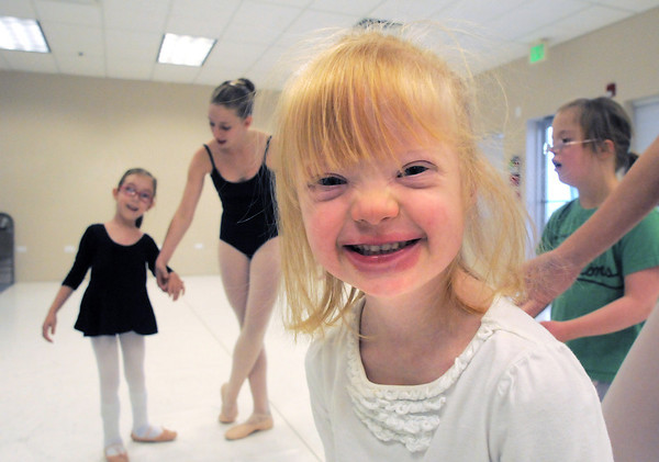 """Jillian Ball, 6, gives a big smile after finishing her dance during Ballet Nouveau Colorado's Ballet Expressions classes for the physically and mentally challenged students on Thursday at the BNC studios.<br /> For more photos please see  <a href=""""http://www.broomfieldenterprise.com"""">http://www.broomfieldenterprise.com</a>.<br /> January 12, 2012<br /> staff photo/ David R. Jennings"""