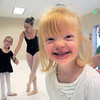 "Jillian Ball, 6, gives a big smile after finishing her dance during Ballet Nouveau Colorado's Ballet Expressions classes for the physically and mentally challenged students on Thursday at the BNC studios.<br /> For more photos please see  <a href=""http://www.broomfieldenterprise.com"">http://www.broomfieldenterprise.com</a>.<br /> January 12, 2012<br /> staff photo/ David R. Jennings"