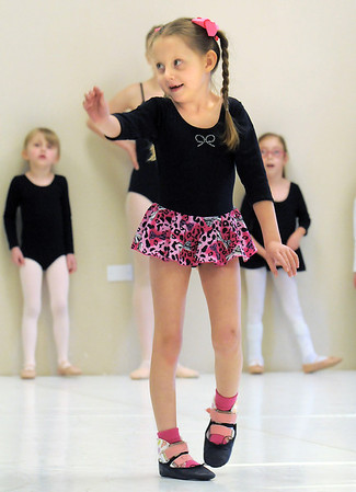 """Sierrah Cummins, 6, dances across the floor during Ballet Nouveau Colorado's Ballet Expressions classes for the physically and mentally challenged students on Thursday at the BNC studios.<br /> For more photos please see  <a href=""""http://www.broomfieldenterprise.com"""">http://www.broomfieldenterprise.com</a>.<br /> January 12, 2012<br /> staff photo/ David R. Jennings"""