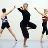 Elizabeth Towles, center, with Megan Coatney, left, and Julie King performs a dance choreographed by Alex Ketley for POP by Ballet Nouveau Colorado during rehearsal at the studio earlier this month.<br /> Sept. 5, 2009<br /> Staff photo/David R. Jennings