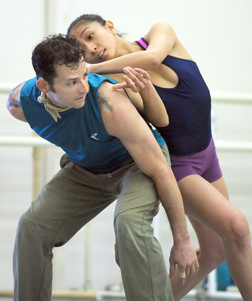 "Marian Faustino and Brandon Freeman perform the dance  ""An Occasional Dream"" set to the music of David Bowie during rehearsal for Ballet Nouveau Colorado's Rock Ballets at the BNC studio on Thursday.<br /> March 29, 2012 <br /> staff photo/ David R. Jennings"