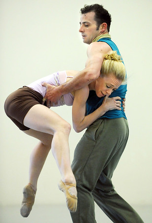 """Sarah Tallman and Brandon Freeman perform the dance """"An Occasional Dream"""" set to the music of David Bowie during rehearsal for Ballet Nouveau Colorado's Rock Ballets at the BNC studio on Thursday.<br /> March 29, 2012 <br /> staff photo/ David R. Jennings"""