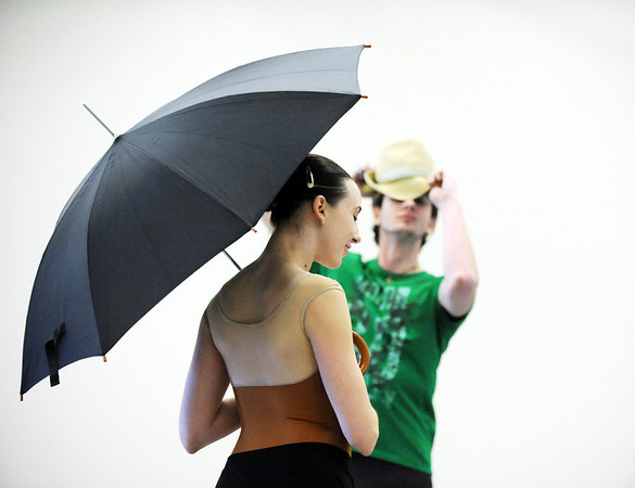 "Meredith Strathmeyer holds an umbrella while dancing with Corbin Kalinowski during the dance  ""An Occasional Dream"" set to the music of David Bowie at rehearsal for Ballet Nouveau Colorado's Rock Ballets at the BNC studio on Thursday.<br /> <br /> March 29, 2012 <br /> staff photo/ David R. Jennings"