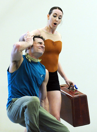 "Meredith Strathmeyer catches Brandon Freeman with her suitcase  during the dance ""An Occasional Dream"" set to the music of David Bowie at rehearsal for Ballet Nouveau Colorado's Rock Ballets at the BNC studio on Thursday.<br /> <br /> March 29, 2012 <br /> staff photo/ David R. Jennings"