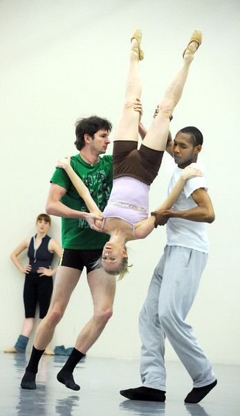 Sarah Tallman is carried upside down by Corbin Kalinowski, left, and Damien Patterson as they perform to the music of David Bowie during rehearsal for Ballet Nouveau Colorado's Rock Ballets at the BNC studio on Thursday.<br /> March 29, 2012 <br /> staff photo/ David R. Jennings