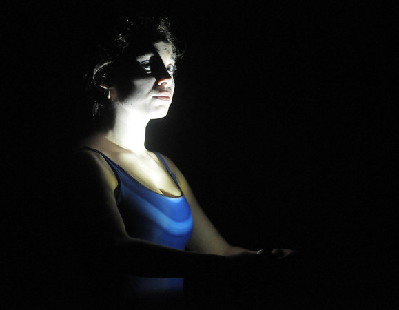 Elizabeth Towles shines a lamp on herself during rehearsal at Ballet Nouveau Colorado on Thursday for the Rarities and Oddities performance.<br /> March 31, 2011<br /> staff photo/David R. Jennings